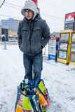 Teenager Doing Groceries during snow storm in Toronto Stock Photos