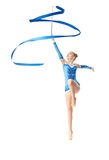 Teenager doing gymnastics dance with ribbon. Young teenager girl doing gymnastics exercise with blue ribbon isolated Stock Photography