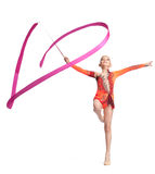 Teenager doing gymnastics dance with ribbon. Young teenager girl doing gymnastics exercise with red ribbon Stock Images