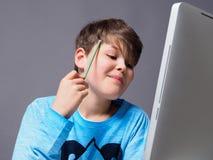 Teenager doing his homework Royalty Free Stock Photos