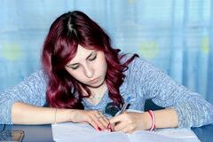 Teenager doing homework Stock Photography