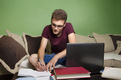 Teenager doing homework at home Royalty Free Stock Photos