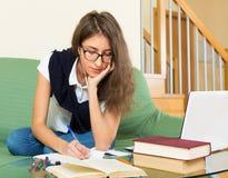 Teenager doing homework Stock Photos