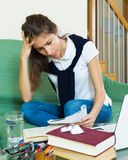 Teenager doing homework Stock Photo