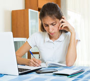 Teenager doing homework. Nervous teenager doing homework at table Royalty Free Stock Photo