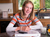 Teenager doing after school homework Stock Photography