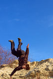Teenager doing somersault. From sand steep. Shot in the Dnieper sands, Ukraine Royalty Free Stock Photo