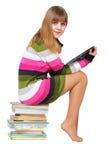 Teenager dolce sul mucchio dei libri Fotografia Stock
