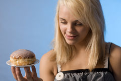 Teenager with the donut. Teenager with the doughnut on the plate Stock Photo