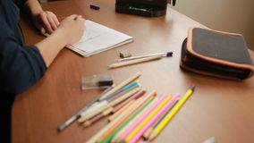 A teenager draws a simple pencil in a notebook. Close-up stock footage