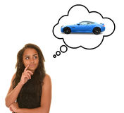 Teenager dreaming of car. Teenage girl with serious expression illustrated with blue sports car in thought bubble isolated on white Stock Photos