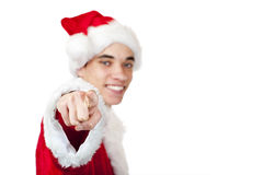 Teenager dressed as santa claus points with finger Stock Photo
