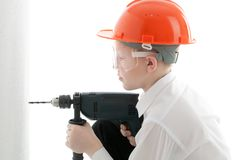 Teenager Drill The Wall Royalty Free Stock Image