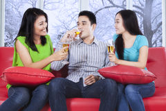 Teenager drink champagne at home Stock Photo