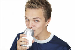 Teenager is drinking. From a can with a white label Stock Image