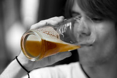 Teenager drinking beer Royalty Free Stock Images