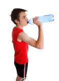 Teenager drinking bottled water Stock Photo