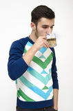 Teenager drinking coffee. Isolated on white background Stock Images