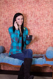 Teenager Drinking Coffee and Talking On the Phone Royalty Free Stock Images
