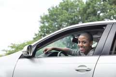 Teenager driving car Stock Image
