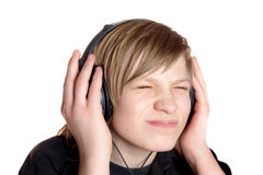 Teenager in ear-phones Royalty Free Stock Images