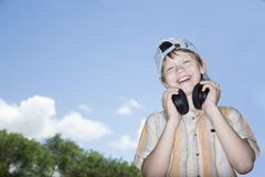 Teenager in ear-phones Royalty Free Stock Photos