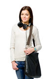 Teenager with earphones and handbag Royalty Free Stock Photo
