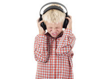Teenager in earphones listens to music Stock Images