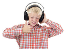 Teenager in earphones listens to music Stock Photography