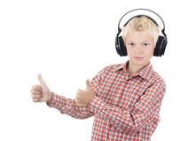 Teenager in earphones listens to music Royalty Free Stock Images
