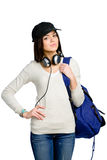 Teenager with earphones and rucksack in peaked cap Stock Photo