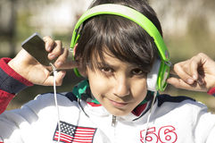 Teenager in earphones. Royalty Free Stock Photo