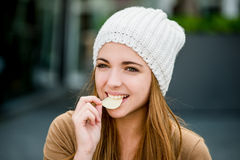 Teenager eating chips royalty free stock photography
