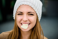 Teenager eating  chips Stock Photos