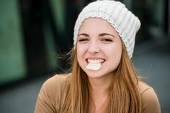 Teenager eating  chips Royalty Free Stock Photo