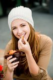 Teenager eating  muffin Royalty Free Stock Image