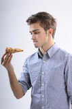 Teenager eating pizza. White, young, handsome man  eating pizza Royalty Free Stock Photography