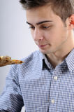 Teenager eating pizza Royalty Free Stock Photos
