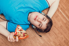Teenager eating pizza. stock image