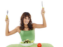 Teenager eating salad. Pretty teenager eating salad over white background Royalty Free Stock Photos