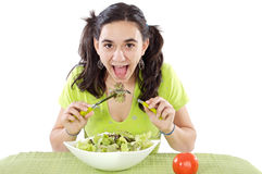 Teenager eating salad Royalty Free Stock Photos