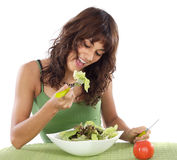 Teenager eating salad Royalty Free Stock Images