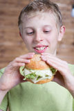 A teenager eating a sandwich Royalty Free Stock Photography