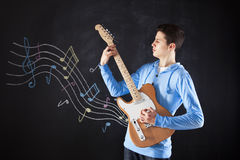 Teenager with an electric guitar Royalty Free Stock Image