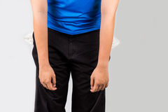 Teenager with empty pockets in discouraging posture Royalty Free Stock Image
