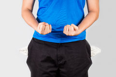 Teenager with empty pockets holding both fists Royalty Free Stock Image