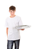 Teenager with Empty Salver Royalty Free Stock Image