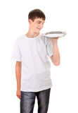 Teenager with Empty Salver Royalty Free Stock Photography