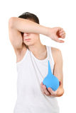 Teenager with Enema Royalty Free Stock Image