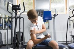The teenager is engaged in power fitness Royalty Free Stock Image